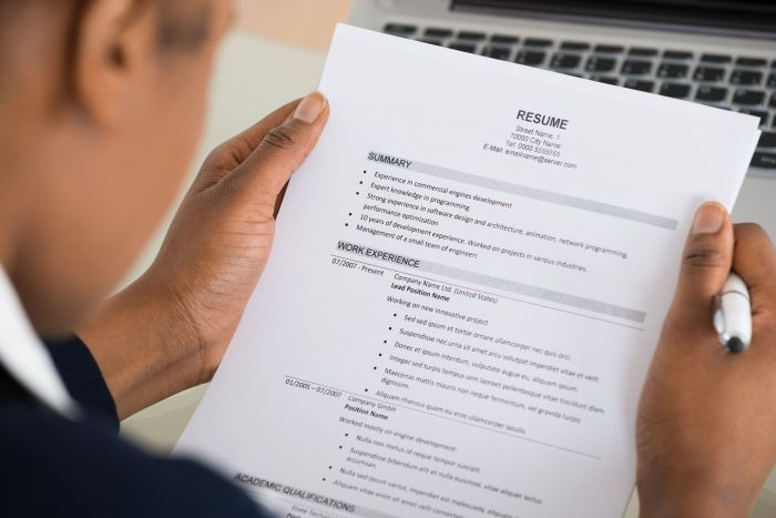 50244939 - close-up photo of a businesswoman holding resume